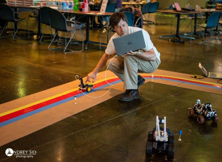Man testing robot at competition