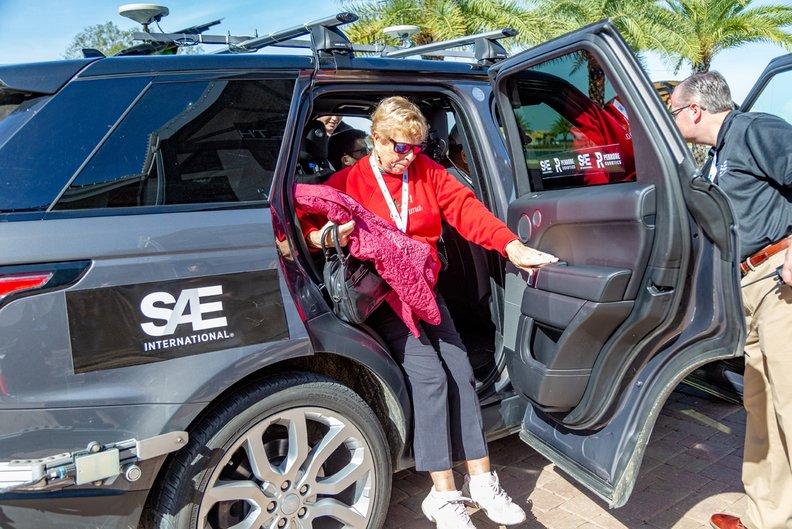 Woman exiting autonomous vehicle